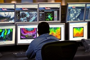 Trading Man at Desk Reviewing Multiple Screens_small (1)